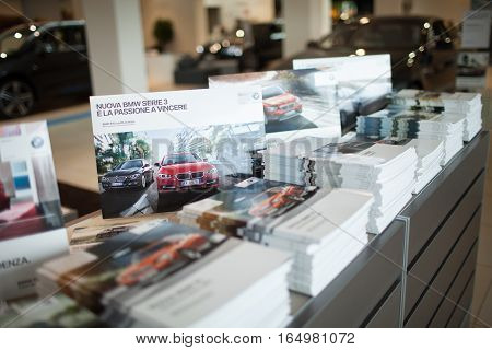 ROME ITALY - MARCH 10 2014: Marketing printed materials promoting BMW cars inside car dealer showroom. The BMW Group recorded increasing of sales in Italy.