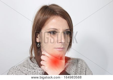 Sick woman suffering from sore throat over a white background