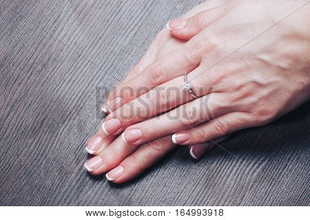 Beautiful female hands with french manicure n