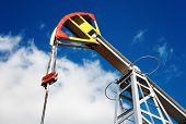 stock photo of nonrenewable  - Oil pump jack against blue sky background - JPG