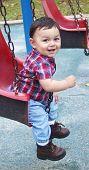 Cute Baby Boy In A Swing poster