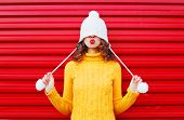 Fashion Happy Woman Blowing Red Lips Makes Air Kiss Wearing Colorful Knitted Hat, Yellow Sweater Ove poster