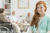 Young Nurse At Retirement Home poster