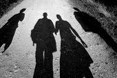 stock photo of person silhouette  - Four people are walking together into the sunlight - JPG