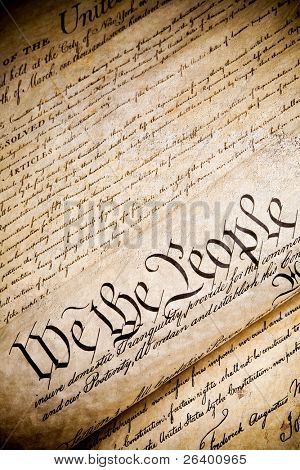 "United States Constitution with ""We The People"" on rough stone background"
