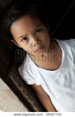 Asian young girl portrait in natural light - Filipina child from impoverished neighborhood in Philippines