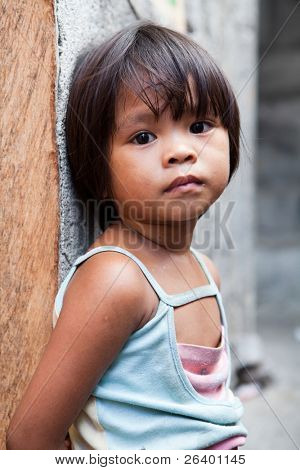 Adorable young girl in the Philippines living in poverty