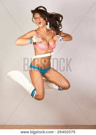 Sexy female go-go dancer jumping. (motion blur)
