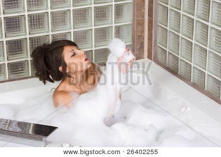 bathtub Sensual sexy female relaxing in hot tub bath with foam soap sud