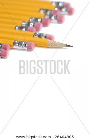 Macro close up of single pencil point amoung eraser ends white background