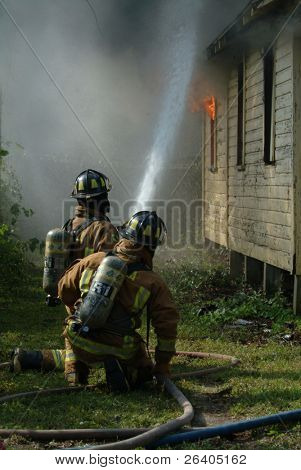 Firefighter battles house fire