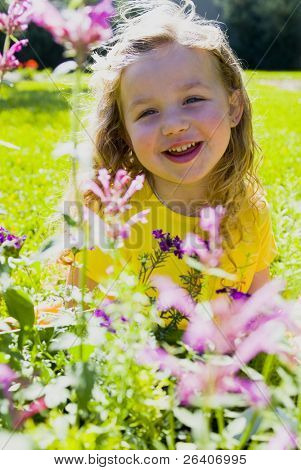 Happy girl in sun with flowers 05