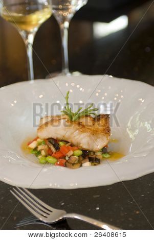 Grilled sea bass seafood dish vegetable salsa with white wine