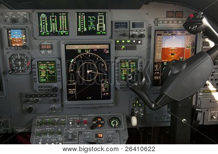 Corporate jet cockpit view with digital instruments