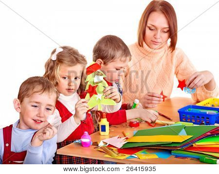 Kindergarden teacher with group children. Isolated on white.
