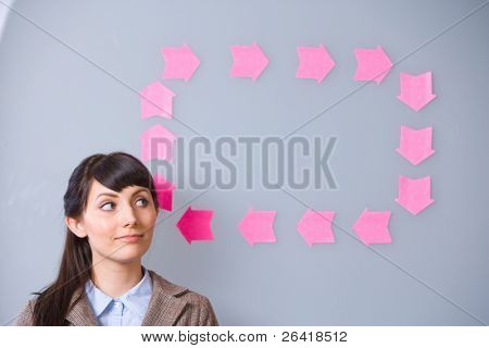 Business Woman thinking with idea bubble