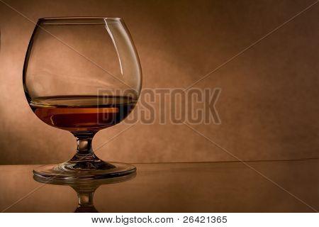 cognac glass on vintage background