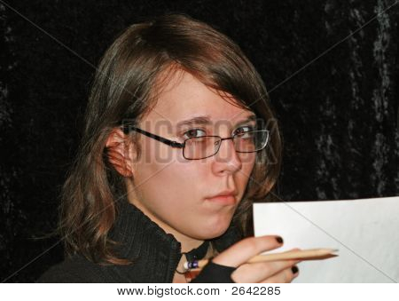 Intellgent Young Lady Doing Paperwork