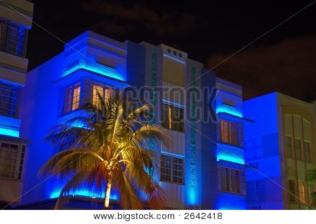 Night-Time Blue Art Deco Hotel In South Beach