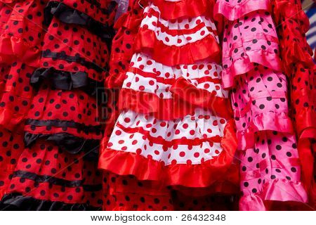 colorful red pink gipsy costumes of flamenco dancer in andalusian