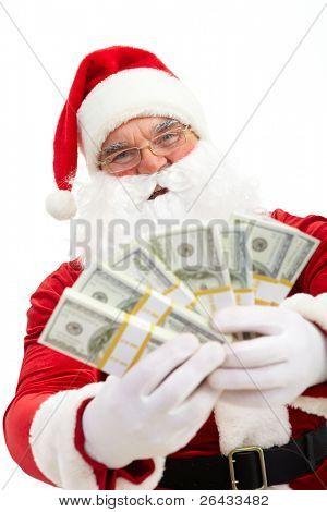 Photo of happy Santa Claus with dollar bills looking at camera