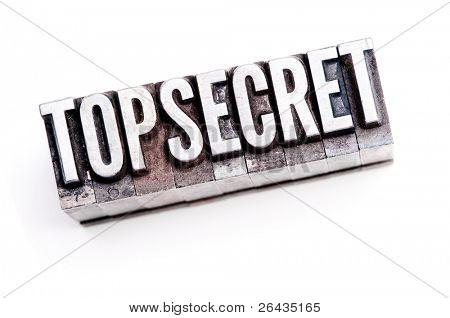 "The phrase ""Top Secret"" in letterpress type. Cross processed & narrow focus."