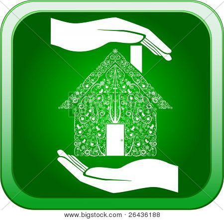 Green home in open hands
