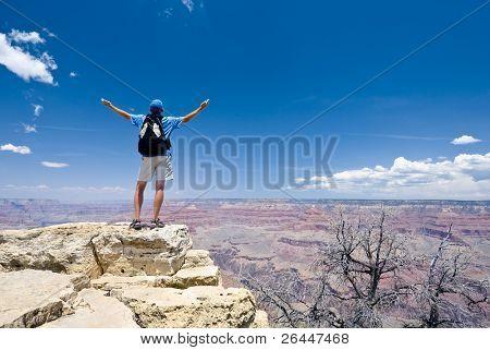Young man on the top of the Crand Canyon. South rim. Arizona. USA