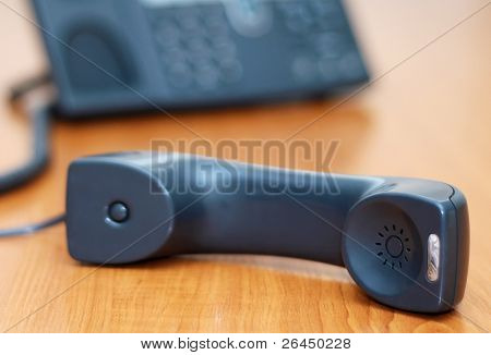 Phone receiver lying on a table