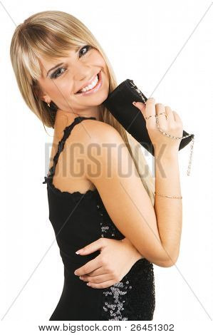 Beautiful young woman in evening gown with a fancy-bag