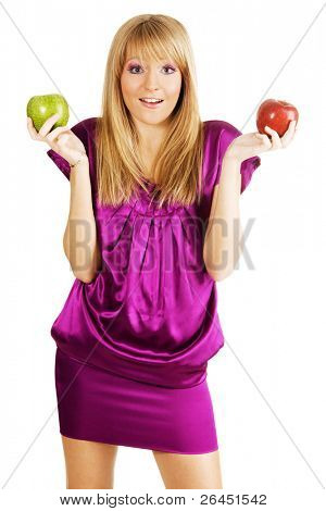 Young beautiful woman holding two apples, isolated on white background