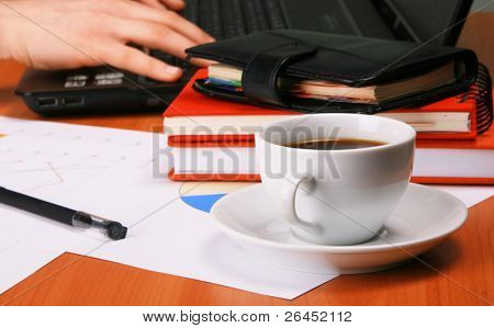 Businessman's workplace with documents and cup of coffee