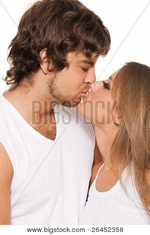 Beautiful yong couple kissing, closeup portrait