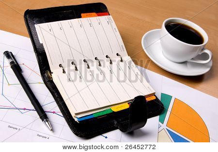 Businessman's workplace with documents and a notebook