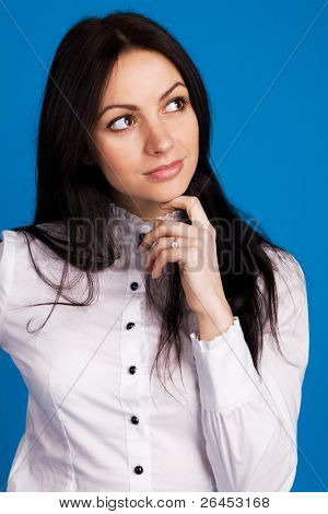 Beautiful young businesswoman, blue background