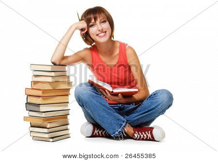 Lovely student with a stack of books, isolated on white