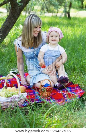 Cheerful mother with her daughter outdoor portrait