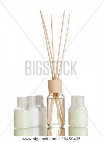 air freshener and bottles isolated on white