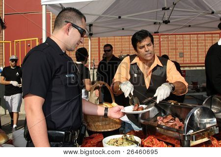 LOS ANGELES - NOV 30:  Eric Estrada at the Hollywood Chamber Of Commerce 17th Annual Police And Fire BBQ at Wilcox Station on November 30, 2011 in Los Angeles, CA