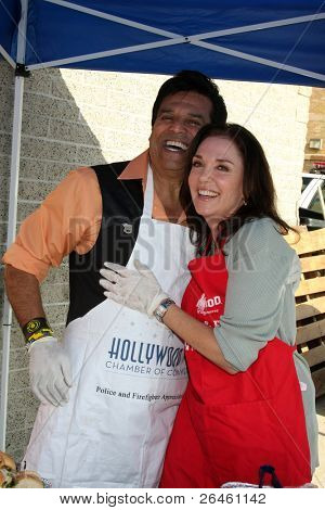 LOS ANGELES - NOV 30:  Erik Estrada, Stepfanie Kramer at the Hollywood Chamber Of Commerce 17th Annual Police And Fire BBQ at Wilcox Station on November 30, 2011 in Los Angeles, CA