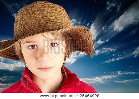 serene child with straw hat