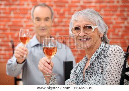 Senior couple celebrating anniversary in a restaurant