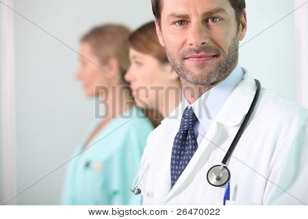 A medical doctor with his assistants