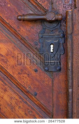 Old handle in wooden doors - close-up