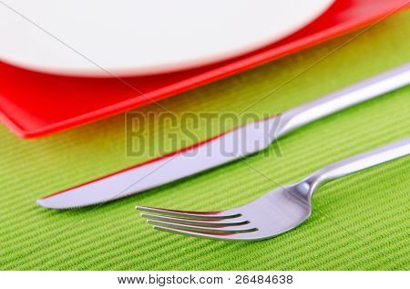 Emtpy plates with utensils on table
