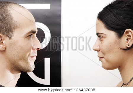 Eye contact - opposites. Portrait of a young couple face to face