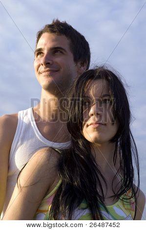Teenage couple looking ahead