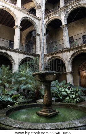 Facade of Old Havana building interior with plants