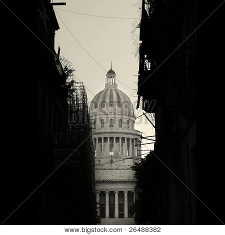 Havana cityscape in black and white - Capitoly dome with shabby buildings silhouette in the front