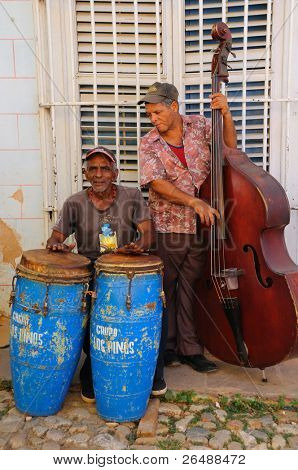 TRINIDAD, CUBA - CIRCA OCT 2008: Traditional musicians play in the street circa October 2008 in Trinidad, Cuba. Trinidad was declared by UNESCO World Heritage Site in 1988